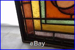 Beautiful vintage stainglass window with iron hinged frame that swings open